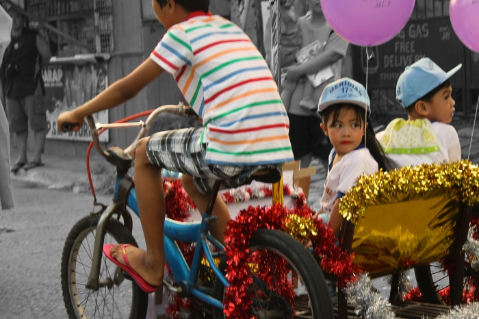 Girl in pedicab splashed
